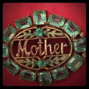 Jewelry - Vintage Broach with turquoise colored gems stones.